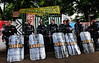 Riot police officers stand guard at the entrance of the old indigenous museum --aka Aldea Maracana-- next to Maracana stadium in Rio de Janeiro, Brazil, January 12, 2013. <br /> Indians of about 10 ethnicities — mostly Guarani, Pataxo, Kaingangue and Guajajara-<br /> have been occupying the place since 2006 as a protest against Rio de Janeiro's governmet decision to throw them out and pull down the building to construct 10,500 parking lots for the upcoming Brazil 2014 FIFA World Cup. (Austral Foto/Renzo Gostoli)