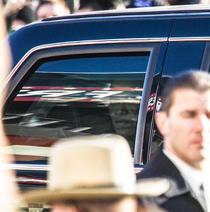 The President peers at the crowd from his limo at 6th and Pennsylvania Ave. NW