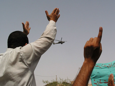 An American helicopter flies over a protest for the release of Islamic religious leader Jassim Al Saedi, in custody of US troops, in Baghdad, Iraq. The US military is finding that invading a nation is easier than ruling it.(Australfoto/Douglas Engle)