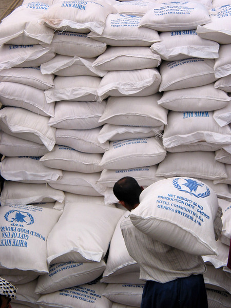 UN WFP rice is loaded onto trucks for distribution in Baghdad, Iraq, June 2, 2003.(Australfoto/Douglas Engle)