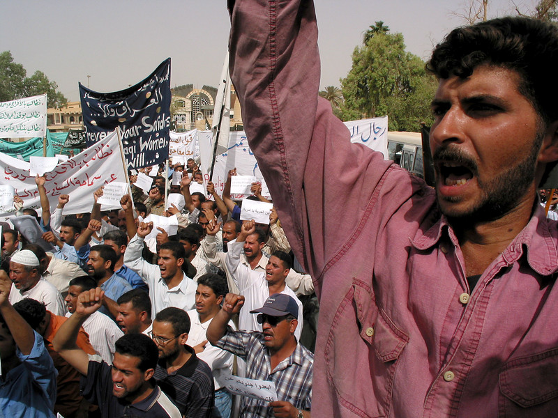 Protestors demand the release of Shiite religious leader Jassim Al Saedi, in custody of US troops, in Baghdad, Iraq. The US military is finding that invading a nation is easier than ruling it.(Australfoto/Douglas Engle)