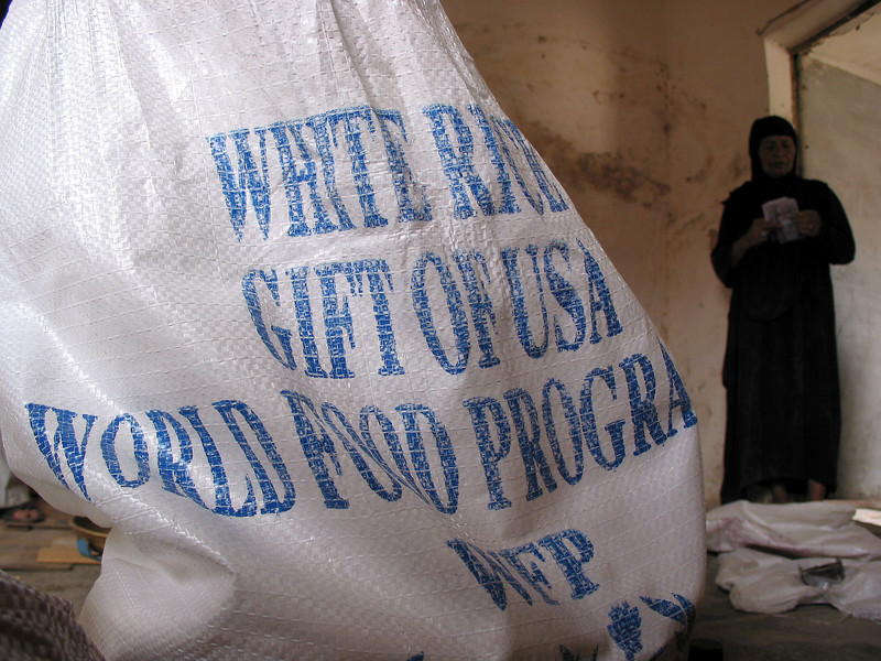 A woman stands next to a sack of UN WFP rice at a  distribution center in Baghdad, Iraq, June 3, 2003.(Australfoto/Douglas Engle)