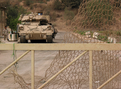 An American Bradley Armored Vehicle keeps guard behind the entrance gate to the former Iraqi Nuclear facility near Baghdad, Iraq. United Nations inspectors will be visiting the facility, which was looted in the days after the US takeover of the country.(Australfoto/Douglas Engle)