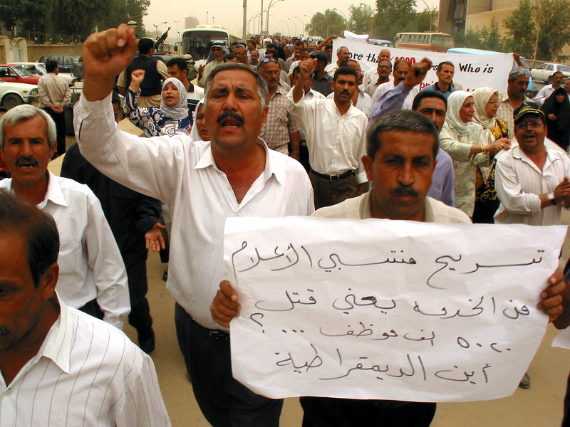 Former Information Ministry employees demand wages and jobs in Baghdad, Iraq. Many former government empolyees have been left jobless since the US occupation of the country.(Australfoto/Douglas Engle)