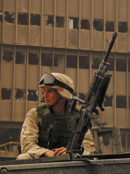 A US soldier keeps watch near a bomb-damaged building in Baghdad, Iraq. The US military is finding that governing a nation is much more work than taking it over.(Australfoto/Douglas Engle)