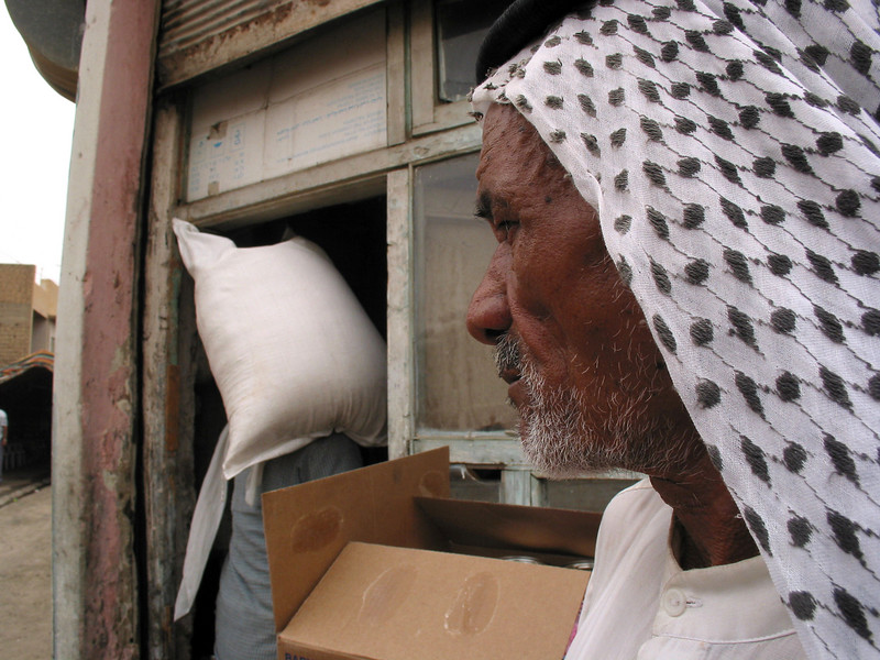 A man watches UN WFP rice delivered to a distribution center in Baghdad, Iraq, June 3, 2003.(Australfoto/Douglas Engle)