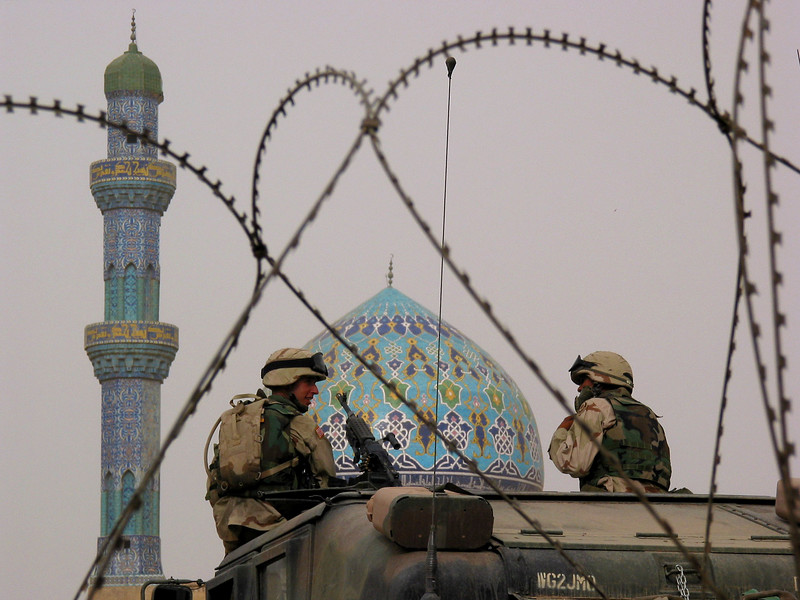 US soldiers keep watch near a mosque in Baghdad, Iraq. The US military is finding that governing a nation is much more work than taking it over.(Australfoto/Douglas Engle)