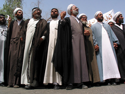 Religious leaders participate in a protest for the release of Islamic Shiite religious leader Jassim Al Saedi, in custody of US troops, in Baghdad, Iraq. The US military is finding that invading a nation is easier than ruling it.(Australfoto/Douglas Engle)