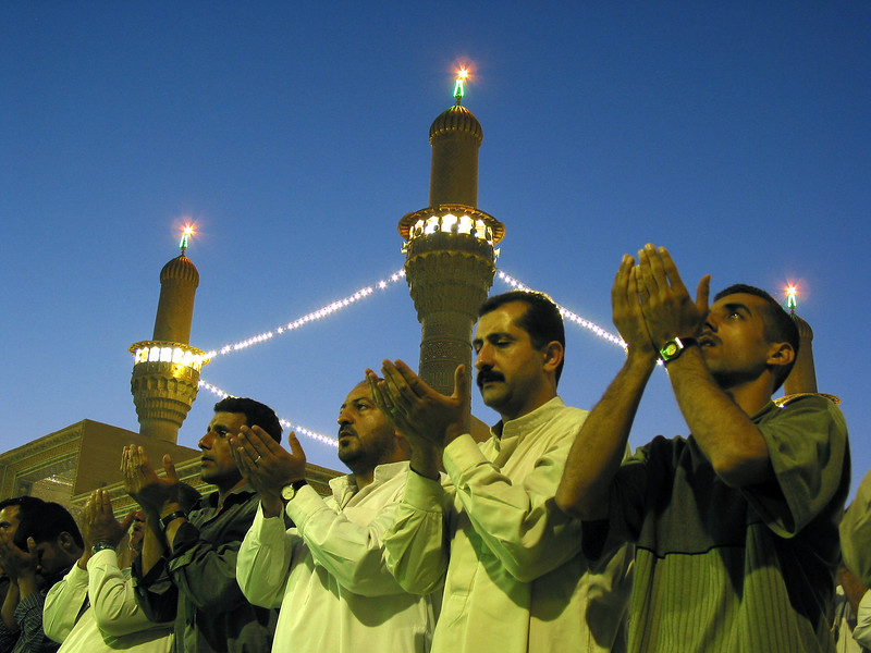 Worshippers pray in the Qadhimiya Mosque during Friday prayer in Baghdad, Iraq. The Shia muslems, who suffered greatly under the rule of Sunni Muslem Saddam Hussein, are now feeling the liberty of practicing their faith freely.(Australfoto/Douglas Engle)