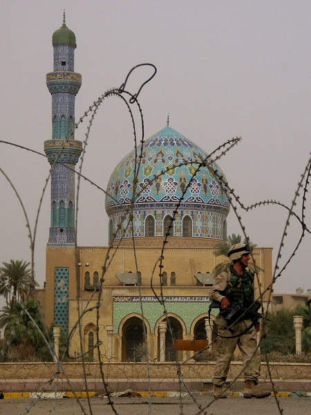 A US soldier walks near a mosque in Baghdad, Iraq. The US military is finding that governing a nation is much more work than taking it over.(Australfoto/Douglas Engle)