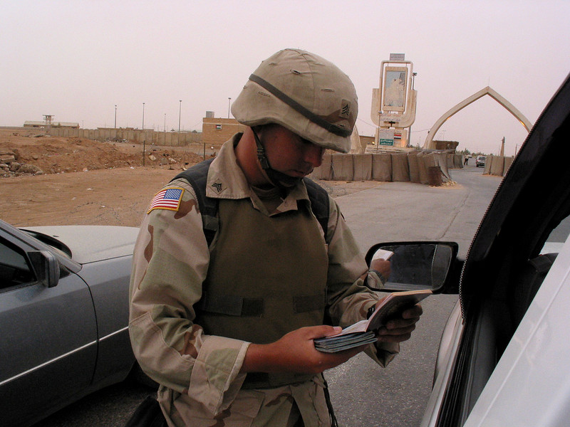 A US soldier checks passports at the Iraq-Jordan border. The US military is finding that governing a nation is much more work than taking it over.(Australfoto/Douglas Engle)