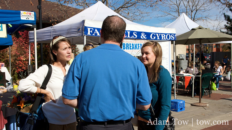 Talking with students at the Farmer's Market.