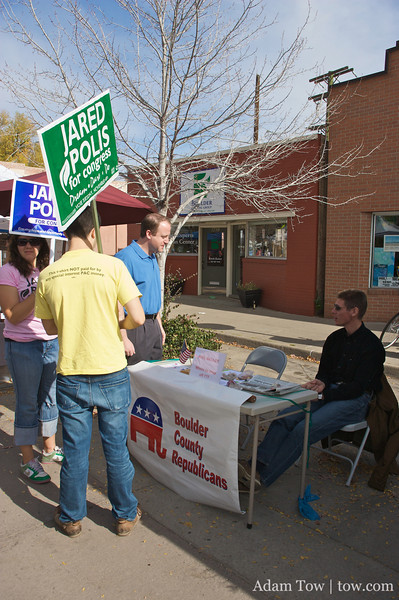 Jared talks with a staff member of the Boulder County Republicans.