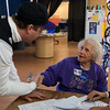Jared shakes hands with a 95-year old woman who wanted to volunteer.