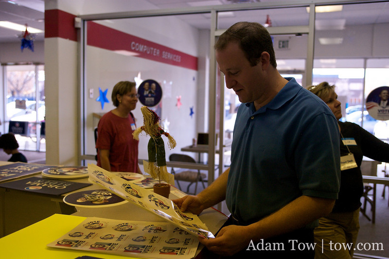 Jared inspects various Obama stickers in the Louisville canvass center.