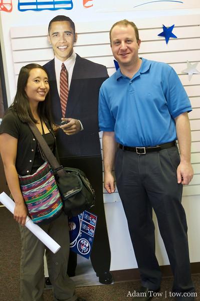 Jared and Rae with a Barack Obama cardboard cutout.