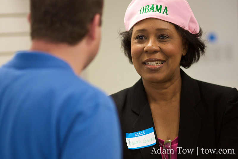 Yvonne Gates speaks with Jared Polis at the Louisville canvass center.