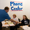 Jared shakes hands with phone center works at a canvass location in Boulder.