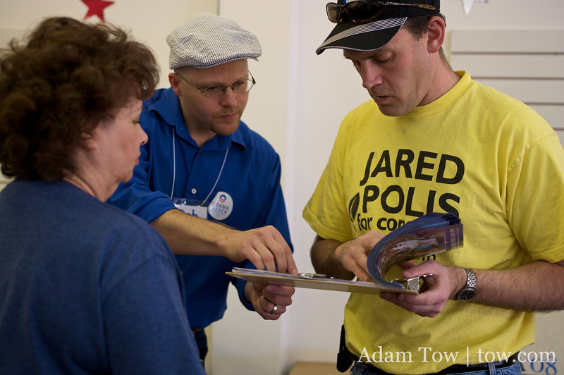 Andy goes over canvassing instructions with canvass captain, Rob.