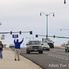 Steve waves to motorists