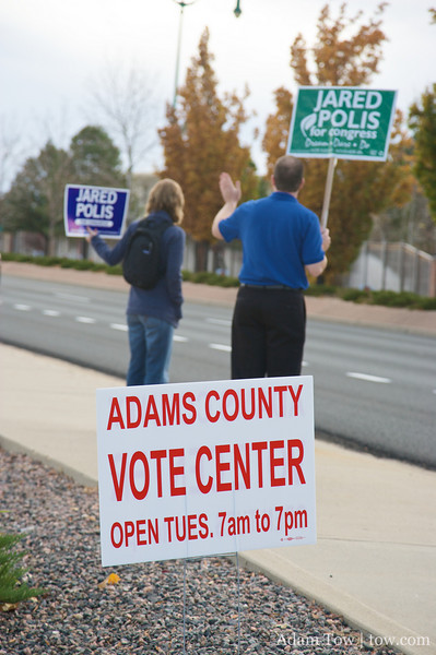 Waving to motorists near the Adams County Vote Center