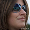 Reflection of a Jared Polis for Congress sign in Lisa's stylish sunglasses.