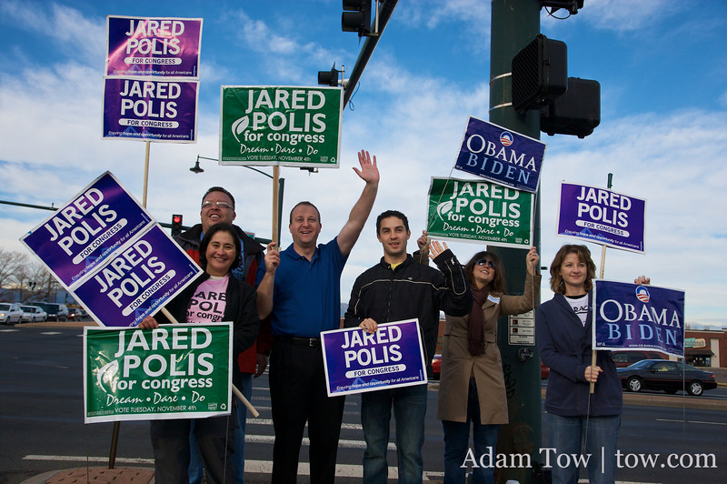 Mugging for the camera, Jared and his team hold up their Polis for Congress signs on Election Day in Boulder, Colorado.