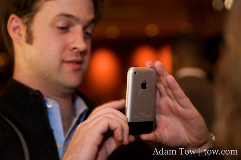 Greg takes an iPhone photo of Jordanna.