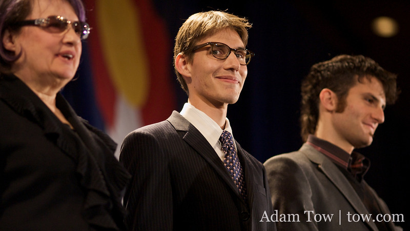Marlon Reis on stage as Jared gives his acceptance speech at the Sheraton in downtown Denver, Colorado.