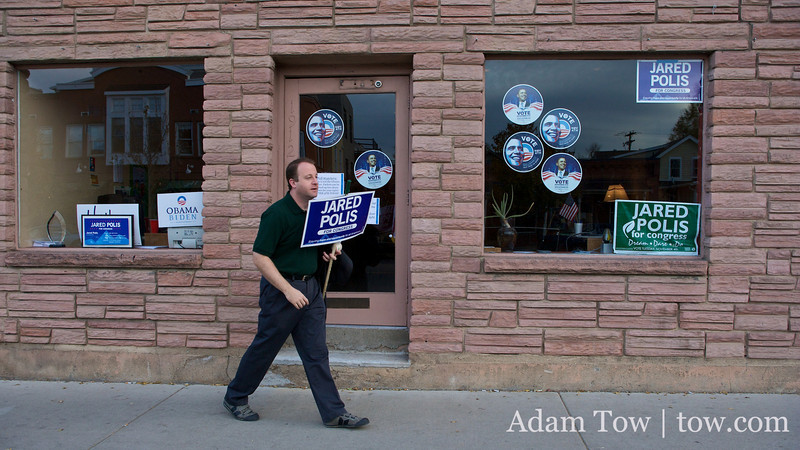 Jared leaves his campaign office with one of his many stick signs.
