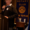 The Rotary Club meeting starts.