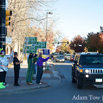 Waving to commuters in Boulder, Colorado.