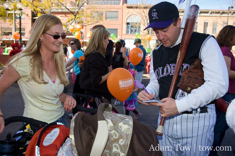 Jared signs his name for a supporter at the Munchkin Masquerade in Boulder.
