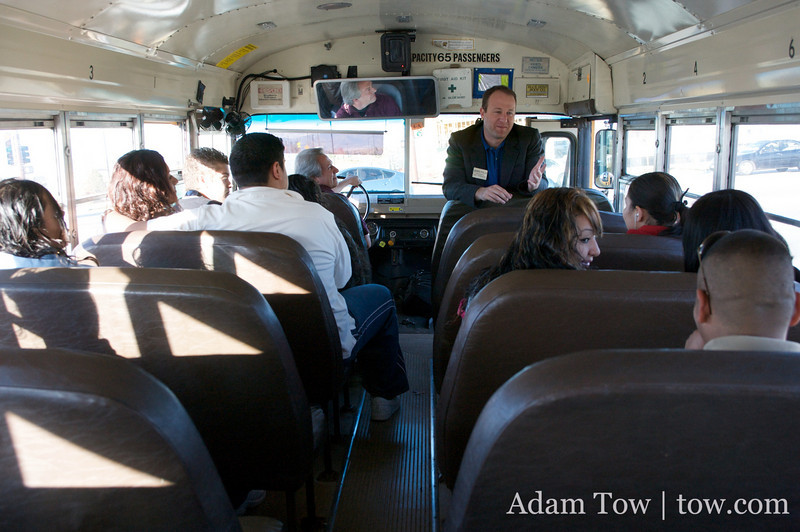 Students on the New America Charter School bus listen to Jared Polis.