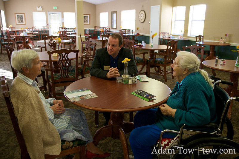 Jared speaks with two members from the Northglenn Heights Assisted Care Center.