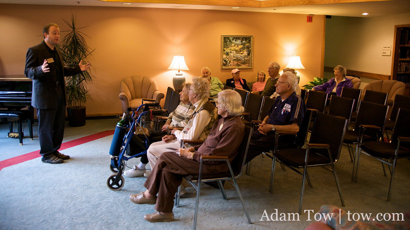 Jared speaks to the assembled group at The Meridian Assisted Living Center.
