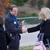Greeting commuters on their way to work at the Thornton Park N Ride.