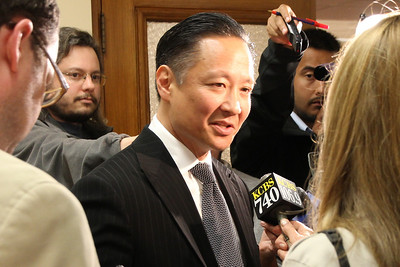 Jeff Adachi conducts a press conference outside of the Department of Elections after filing his paperwork and oath to enter the San Francisco mayor's race.