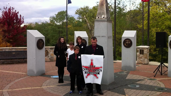 Jeff Christiansen, an 18-year veteran with the DuPage County Sheriff's Office, declared his candidacy for Kendall County Sheriff today, Saturday, Oct. 26 in front of the Veteran's Memorial in Oswego.