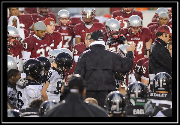 Players from both WSU and Portland take a knee after QB Gary Rogers is taken off the field after a neck injury