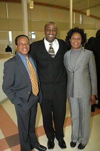 Dr. Opara & wife pose with KC (middle).