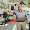 Vice President of Fosta-Tek Optics in Leominster James LeBlanc chats with candidate for Lt. Governor Karyn Polito when she visited the company on Monday. Here he shows off some of their equipment they use in the quality assurance lab in the facility. SENTINEL & ENTERPRISE/JOHN LOVE