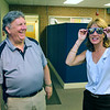 Vice President of Fosta-Tek Optics in Leominster James LeBlanc chats with candidate for Lt. Governor Karyn Polito when she visited the company on Monday. Leblanc has a good laugh as Polito tries on an old pair of Fosta Grants that the company used to make. SENTINEL & ENTERPRISE/JOHN LOVE