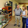 Vice President of Fosta-Tek Optics in Leominster James LeBlanc chats with candidate for Lt. Governor Karyn Polito, center, about what they made and still make when she visited the company on Monday. With them is Councilor at Large Clair Freda. SENTINEL & ENTERPRISE/JOHN LOVE