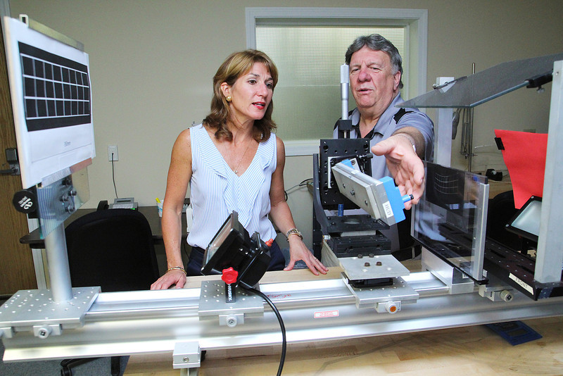 Vice President of Fosta-Tek Optics in Leominster James LeBlanc chats with candidate for Lt. Governor Karyn Polito when she visited the company on Monday. LeBlanc explains to Polito one of the machines that they bought to make stuff for the government. SENTINEL & ENTERPRISE/JOHN LOVE