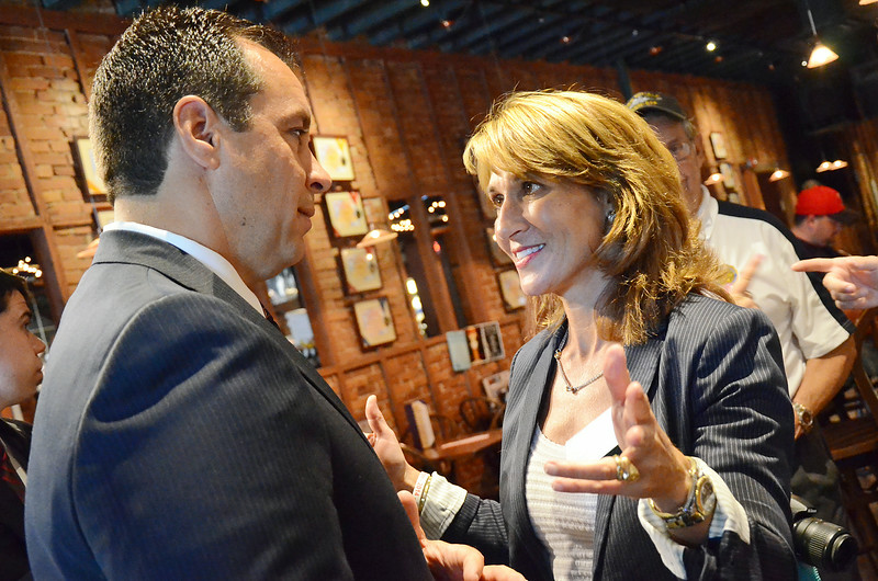 Officials toured the city of Gardner on Thursday afternoon, ending at the Gardner Ale House. Gardner Mayor Mark Hawke chats with candidate for Liuetenant Governor Karyn Polito. SENTINEL & ENTERPRISE / Ashley Green