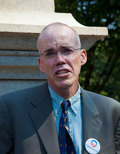 Bill McKibben, the prominent climate activist and founder of 350.org. gives a pep talk prior to a demonstration. He was among the 65 environmentalists arrested on August 20, 2011, outside the White House in Washington DC, as part of a demonstration urging President Obama to block the proposed Keystone XL pipeline that would bring oil from Canada's oil sands projects to Gulf Coast refineries. The proposed $7 billion, 1,700 mile pipeline needs State Department approval to proceed, and the Obama administration plans to make a decision by the end of the year. This latest act of civil disobedience was the beginning of  two weeks of White House demonstrations, with more arrests expected daily. Among those arrested on August 20 were McKibben; Gus Speth, whose career includes co-founding the Natural Resources Defense Council and chairing the White House Council on Environmental Quality in the Carter Administration; and Jane Hamsher, who founded the popular progressive blog Firedoglake. (Photo by Jeff Malet)