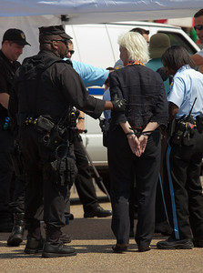 Police arrested Jane Hamsher, who founded the popular progressive blog Firedoglake, and 64 other environmentalists on August 20, 2011, outside the White House in Washington DC, as part of a demonstration urging President Obama to block the proposed Keystone XL pipeline that would bring oil from Canada's oil sands projects to Gulf Coast refineries. The proposed $7 billion, 1,700 mile pipeline needs State Department approval to proceed, and the Obama administration plans to make a decision by the end of the year. This latest act of civil disobedience was the beginning of  two weeks of White House demonstrations, with more arrests expected daily. Among those arrested on August 20 were Bill McKibben, the prominent climate activist and founder of 350.org; and Gus Speth, whose career includes co-founding the Natural Resources Defense Council and chairing the White House Council on Environmental Quality in the Carter Administration.  (Photo by Jeff Malet)