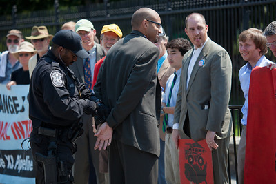Police arrested 65 environmentalists on August 20, 2011, outside the White House in Washington DC, as part of a demonstration urging President Obama to block the proposed Keystone XL pipeline that would bring oil from Canada's oil sands projects to Gulf Coast refineries. The proposed $7 billion, 1,700 mile pipeline needs State Department approval to proceed, and the Obama administration plans to make a decision by the end of the year. This latest act of civil disobedience was the beginning of  two weeks of White House demonstrations, with more arrests expected daily. Among those arrested on August 20 were Bill McKibben, the prominent climate activist and founder of 350.org; Gus Speth, whose career includes co-founding the Natural Resources Defense Council and chairing the White House Council on Environmental Quality in the Carter Administration; and Jane Hamsher, who founded the popular progressive blog Firedoglake. (Photo by Jeff Malet)