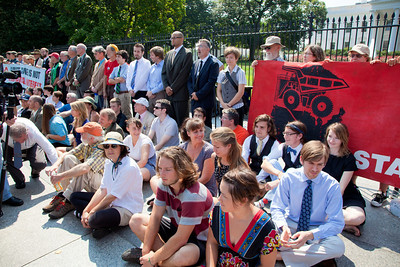 """Police arrested 65 environmentalists on August 20, 2011, outside the White House in Washington DC, as part of a demonstration urging President Obama to block the proposed Keystone XL pipeline that would bring oil from Canada's oil sands projects to Gulf Coast refineries. The proposed $7 billion, 1,700 mile pipeline needs State Department approval to proceed, and the Obama administration plans to make a decision by the end of the year. This latest act of civil disobedience was the beginning of  two weeks of White House demonstrations, with more arrests expected daily. Among those arrested on August 20 were Bill McKibben, the prominent climate activist and founder of 350.org; Gus Speth, whose career includes co-founding the Natural Resources Defense Council and chairing the White House Council on Environmental Quality in the Carter Administration; and Jane Hamsher, who founded the popular progressive blog Firedoglake. Sign (right) in photo reads """"We Sit-In Against the XL Pipeline. Obama, Will You Stand Up to Big Oil?"""" (Photo by Jeff Malet)"""